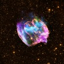 This highly distorted supernova remnant may contain the most recent black hole formed in the Milky Way galaxy. The composite image combines X-rays from Chandra (blue and green), radio data from the Very Large Array (pink), and infrared data from the Palomar Observatory (yellow). Most supernova explosions that destroy massive stars are generally symmetrical.  In the W49B supernova, however, it appears that the material near its poles was ejected at much higher speeds than that at its equator.  There is also evidence that the explosion that produced W49B left behind a black hole and not a neutron star like most other supernovas.